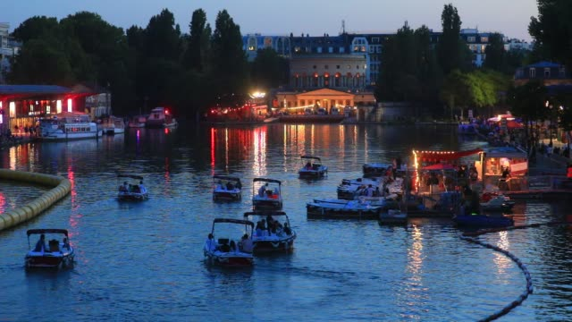 """boats return to docking after the paris plages launch of """"le cinema sur l'eau"""" with the screening of """"le grand bain"""" at bassin de la villette on july... - laziness stock videos & royalty-free footage"""