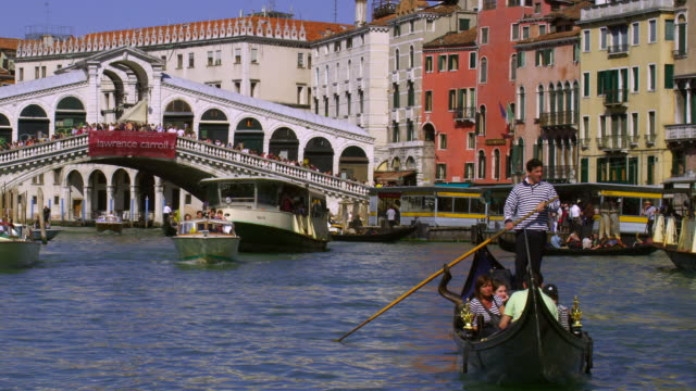 boats sail on the grand canal in venice, italy. - grand canal venice stock videos & royalty-free footage