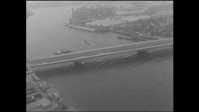 boats sail on the sumida river near the newly completed tsukuda-ohashi. - 1964 stock videos and b-roll footage