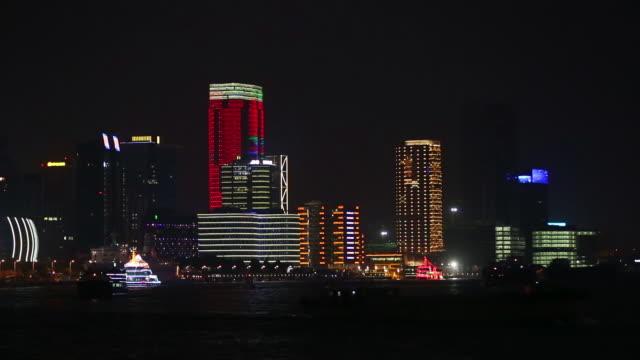 boats sailing along the huangpu river and past the bund, shanghai, china - river huangpu stock videos & royalty-free footage