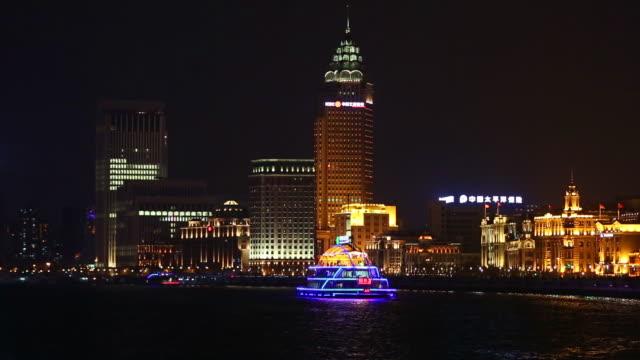 boats sailing along the huangpu river and past zhongshan road, shanghai, china - river huangpu stock videos & royalty-free footage
