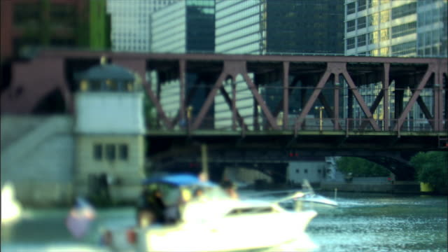 boats sailing around michigan avenue bridge - michigan avenue bridge stock videos and b-roll footage