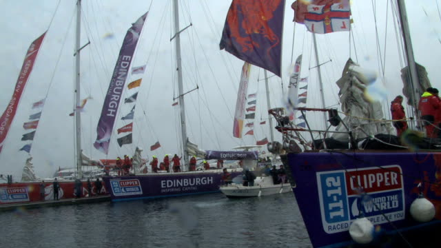 boats set off in the rain from the docks of qingdao, china, for san francisco on the longest leg of this 40,000 mile ocean race challenge / sailors... - stephenie hollyman stock videos & royalty-free footage
