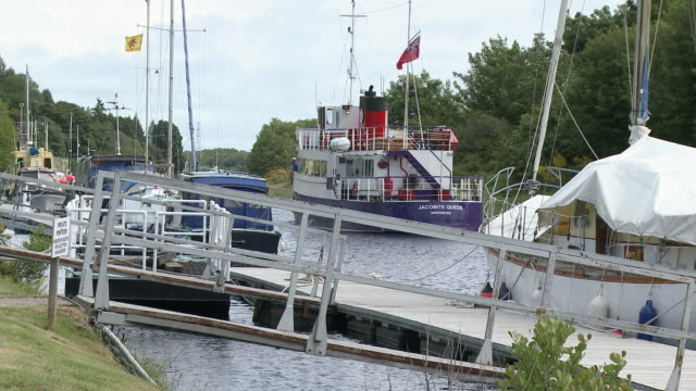MS Boats standing on small dock on river / Inverness, Highlands, Scotland