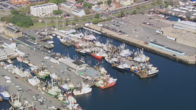 aerial boats tied up in marina / new bedford, massachusetts, united states - new bedford stock videos & royalty-free footage