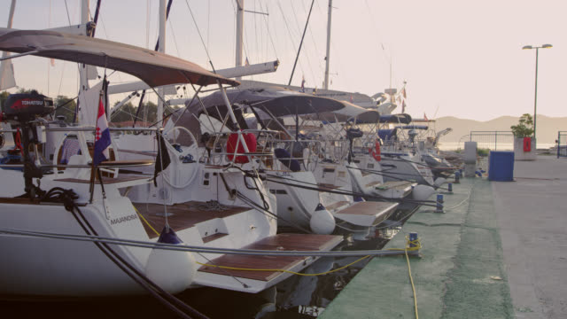 ws boats tied up on a pier - pier video stock e b–roll