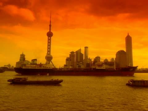 boats travel on the huangpu river near shanghai china - river huangpu stock videos & royalty-free footage