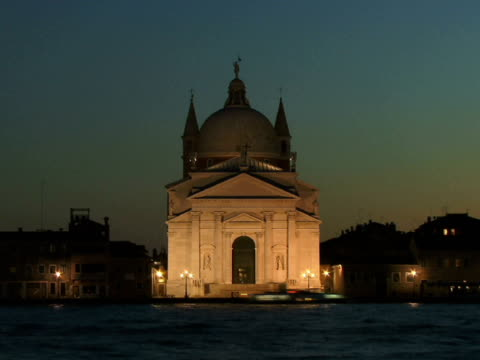 stockvideo's en b-roll-footage met t/l ws boats traveling on canal past illuminated redentore church / venice, italy - onbekend geslacht