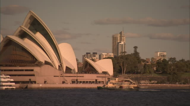 ws pan boats traveling past sydney opera house / sydney, australia - unknown gender stock videos & royalty-free footage