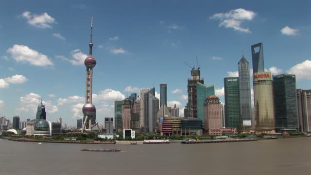 ws tl boats travelling on huangpu river past pudong skyline / shanghai, china - river huangpu stock videos & royalty-free footage