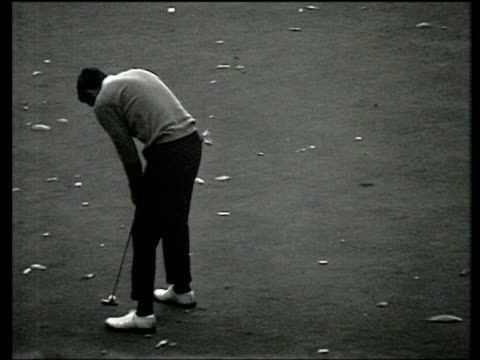 bob charles pushes his putt wide to give gary player victory on 18th green world matchplay championship final wentworth 1968 - pga world golf championship stock videos & royalty-free footage