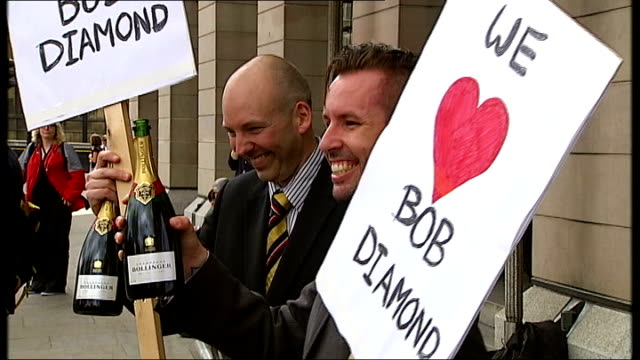 Bob Diamond gives evidence to MPs ENGLAND London EXT Demonstrators outside Bank of England dressed in suits as one uncorks bottle of champagne and...