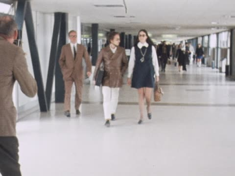 Bob Dylan with his pregnant wife Sarah at London Heathrow Airport