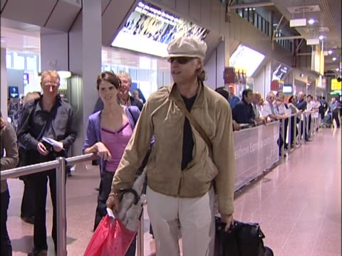 stockvideo's en b-roll-footage met bob geldof arrives at heathrow laden with luggage after factfinding trip to ethiopia to examine success of band aid projects - bob geldof
