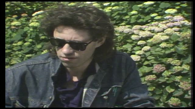 "bob geldof recalls his reaction to viewing the footage of the ethiopian famine: ""disgust, outrage, horror, shame...how many times must you see a... - 1985 stock videos & royalty-free footage"