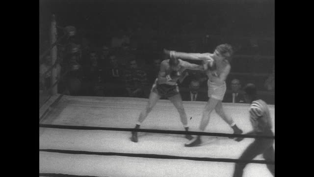 bob grier and bob white box during a golden glove match in new york / grier knocks out white for the win - glove box stock videos & royalty-free footage