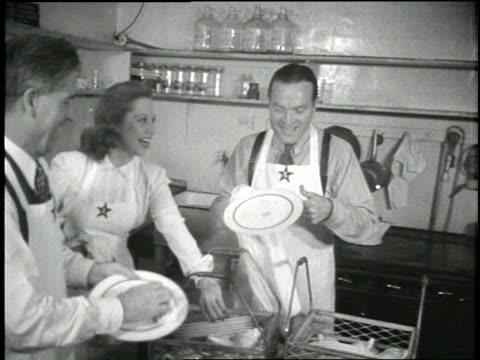 Bob Hope and Dinah Shore help dry dishes at a canteen