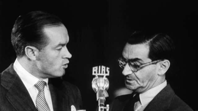 bob hope and irving berlin perform for a crowd of soldiers who were involved in the berlin airlift / soldiers and crowd lined up outside building,... - ボブ ホープ点の映像素材/bロール