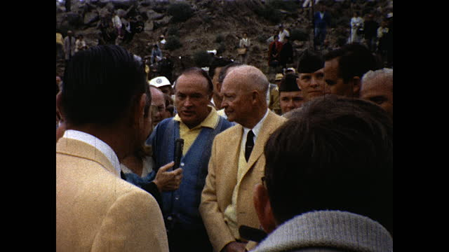 bob hope and president eisenhower standing in the crowd being interviewed, then walks through the crowd; blonde woman in white hat walks through the... - beautiful woman stock videos & royalty-free footage