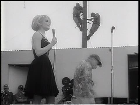 bob hope + joey heatherton dancing wackily on stage / uso show / vietnam war - bob hope komiker stock-videos und b-roll-filmmaterial