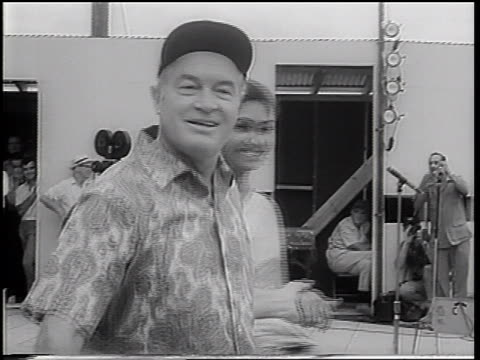 Bob Hope leading Miss World onto stage in USO show / Vietnam War