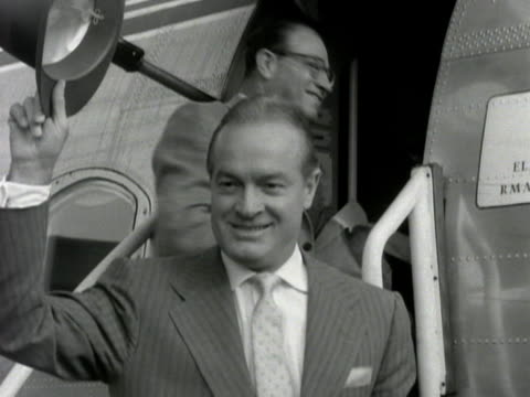 bob hope poses for photographs as he arrives at london airport. - actress stock videos & royalty-free footage