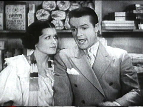 """bob hope singing """"just say you'd be my cookie"""" to a young adult caucasian woman behind the sales counter in a general store. adult caucasian female... - bob hope komiker stock-videos und b-roll-filmmaterial"""