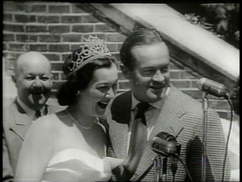 bob hope speaks to a crowd at the 22nd shenandoah apple blossom festival alongside the parade's queen / bob hope jokes with the festival queen / the... - narrating stock videos & royalty-free footage