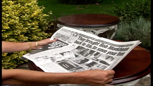 bob monkhouse tv advert for prostate cancer research foundation; england: ext set-up shots jackie monkhouse sitting in garden looking at newspaper... - bob monkhouse stock videos & royalty-free footage