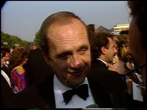 bob newhart at the 1987 emmy awards with stuart pankin at the pasadena civic auditorium in pasadena, california on september 20, 1987. - ボブ ニューハート点の映像素材/bロール