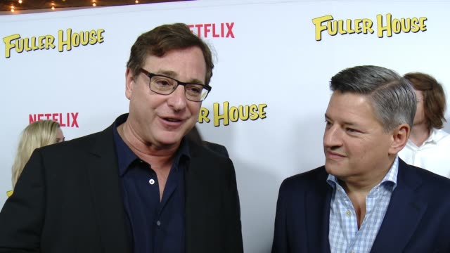 vídeos de stock, filmes e b-roll de interview bob saget and ted sarandos on what it's like to be part of this new series and what fans should expect at the netflix's fuller house... - the grove los angeles