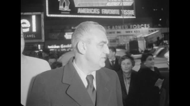 MS of Bob Weitman on sidewalk outside NYC movie premiere of The Eddie Cantor Story