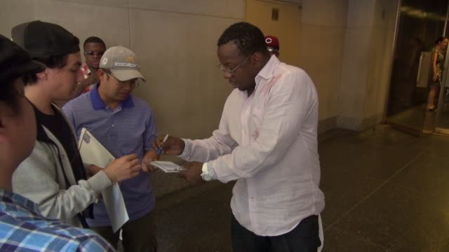 Bobby Brown signs for poses with fans outside of the TODAY show in Rockefeller Center in Celebrity Sightings in New York
