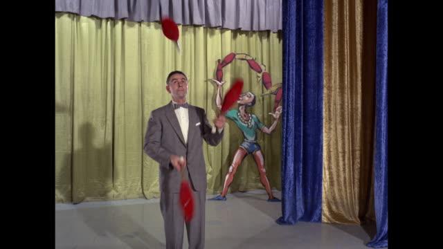 bobby daniels juggles three clubs - juggling stock videos & royalty-free footage