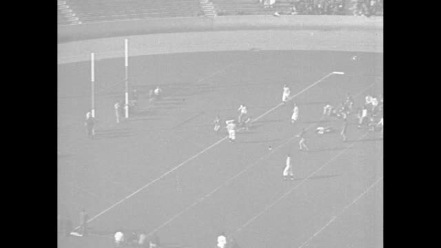 Bobby Grayson of Stanford passes to Jim Moscrip for gain / crowd / Stanford touchdown / wipe / Illinois kicks off to Army / Army blocked kick...