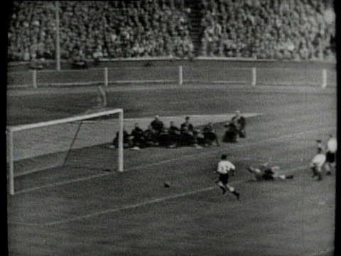 bobby johnstone races through to score, players and fans celebrate, birmingham city vs manchester city, 1956 fa cup final, wembley, london - 1956 stock-videos und b-roll-filmmaterial