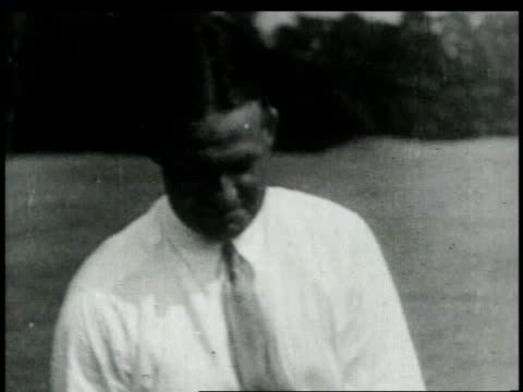 stockvideo's en b-roll-footage met cu bobby jones / bobby jones tees off - 1949