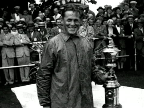 stockvideo's en b-roll-footage met bobby jones smiling with trophy at national amateur golf championship / instructional - 1927
