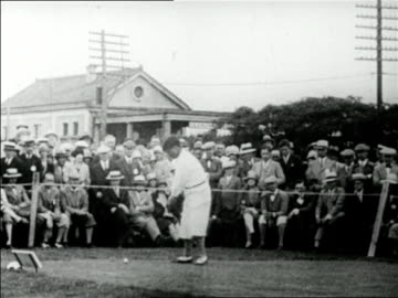 vidéos et rushes de bobby jones teeing off as crowd in background looks on / mateson, il / u.s. open / newsreel - 1928