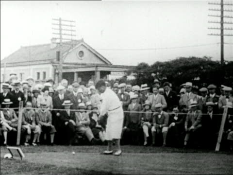 vídeos y material grabado en eventos de stock de bobby jones teeing off as crowd in background looks on / mateson, il / u.s. open / newsreel - 1928