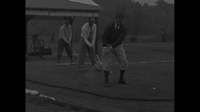 bobby jones tommy armour horton smith drive golf balls one after another / whirling part of golf ball machine / vs arm of contraption / golf balls... - knickers stock videos & royalty-free footage