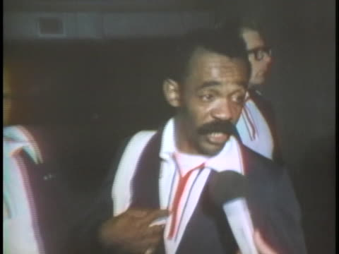bobby lewis, the u.s. olympic boxing coach, explains that the team is in munich to box and not to partake in politics. - 1972年点の映像素材/bロール