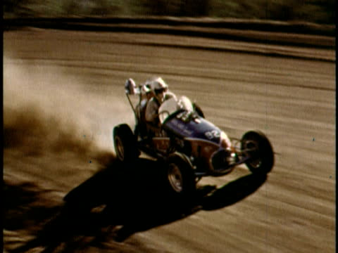 Bobby Unser driving race car on dirt track/ Pike's Peak Colorado