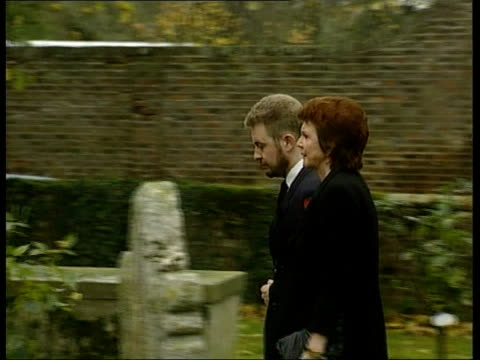 bobby willis funeral; itn england: buckinghamshire: denham: ext coffin of bobby willis carried along with cilla black and son robert following behind... - gloria hunniford stock-videos und b-roll-filmmaterial