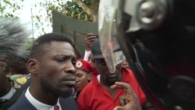 bobi wine a ugandan pop star turned mp who became a high profile government critic tries to leave his house after having been put under house arrest - critic stock videos & royalty-free footage