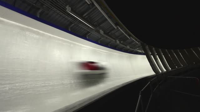 WS Bobsled passing through frame on sliding Centre course / Whistler, British Columbia, Canada