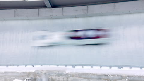 bobsleigh track with bob passing by - bobsledding stock videos & royalty-free footage