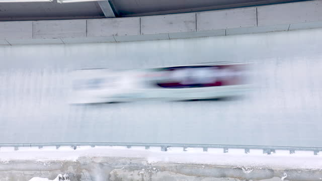 bobsleigh track with bob passing by - bobsleighing stock videos & royalty-free footage