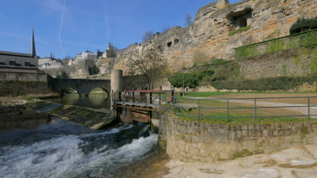 bock casemates with alzette river and the neumuenster abbey, grund district, luxembourg city, grand duchy of luxembourg - luxembourg benelux stock videos & royalty-free footage