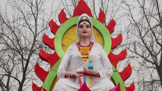 ms zo bodhisattva shaped lanterns celebrate for spring festival with porcelain dishes at the small wild goose pagoda park / xi'an, shaanxi, china - female likeness stock videos & royalty-free footage